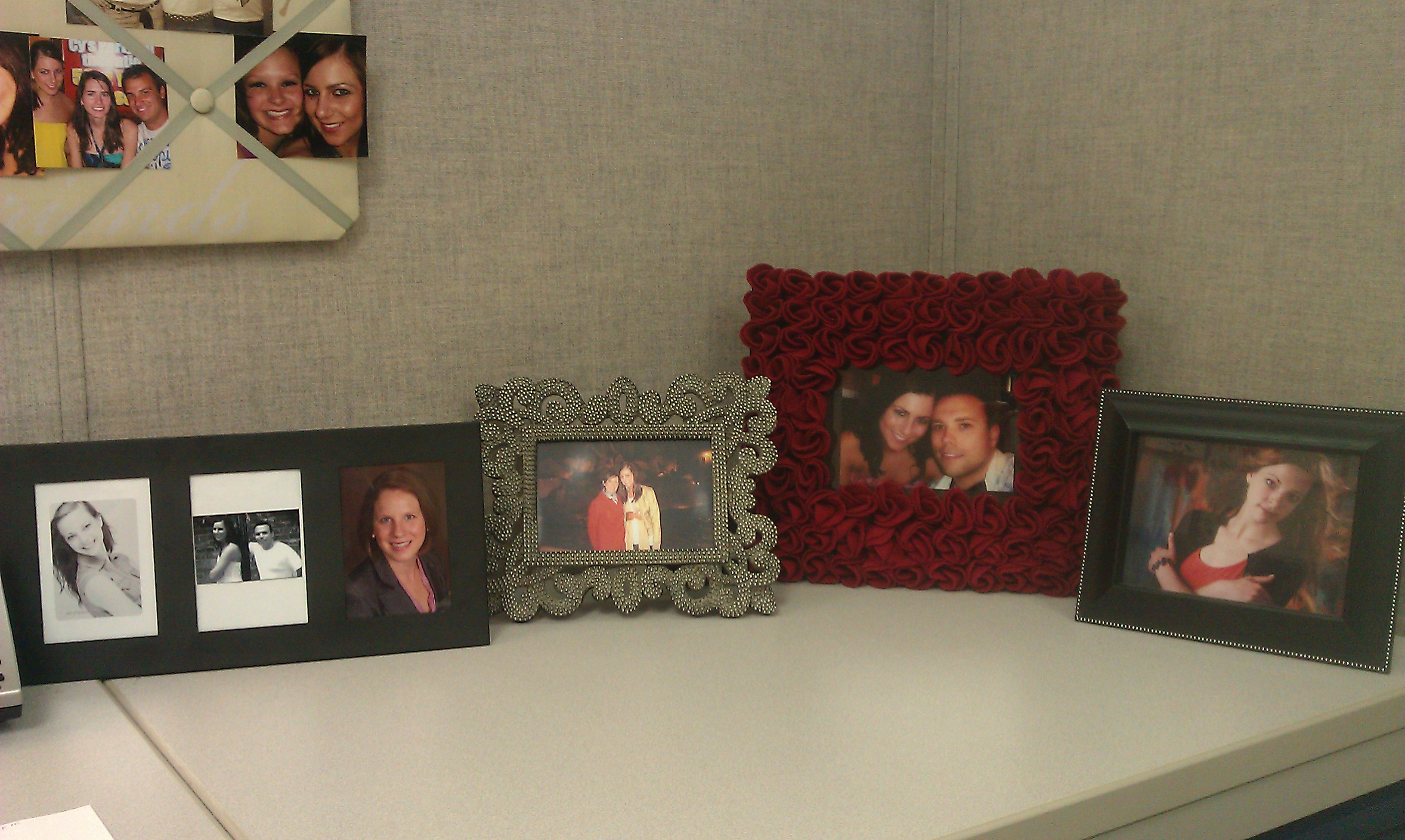 some pretty picture frames add the perfect touch to my cubicle