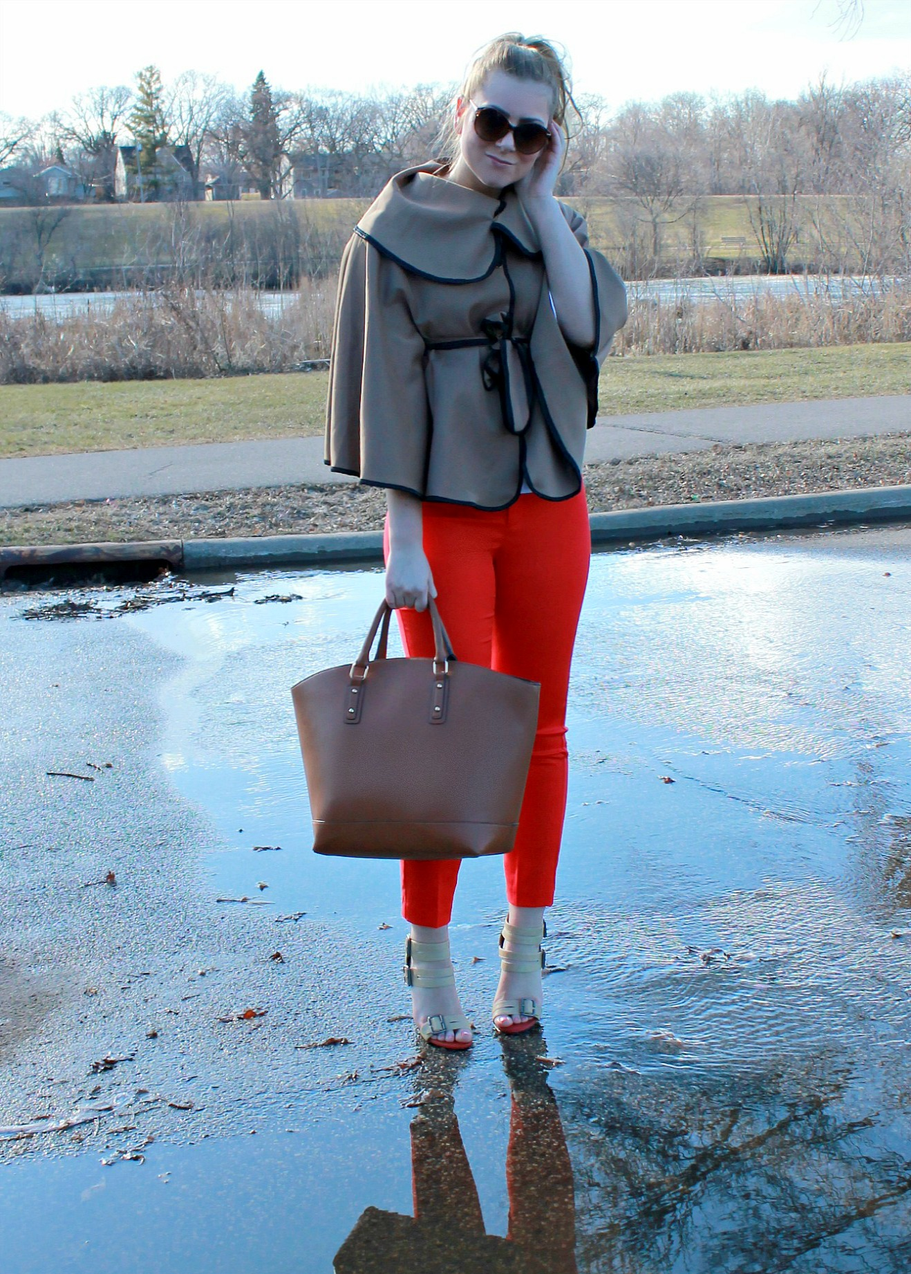 red cropped pants + cape + large tote