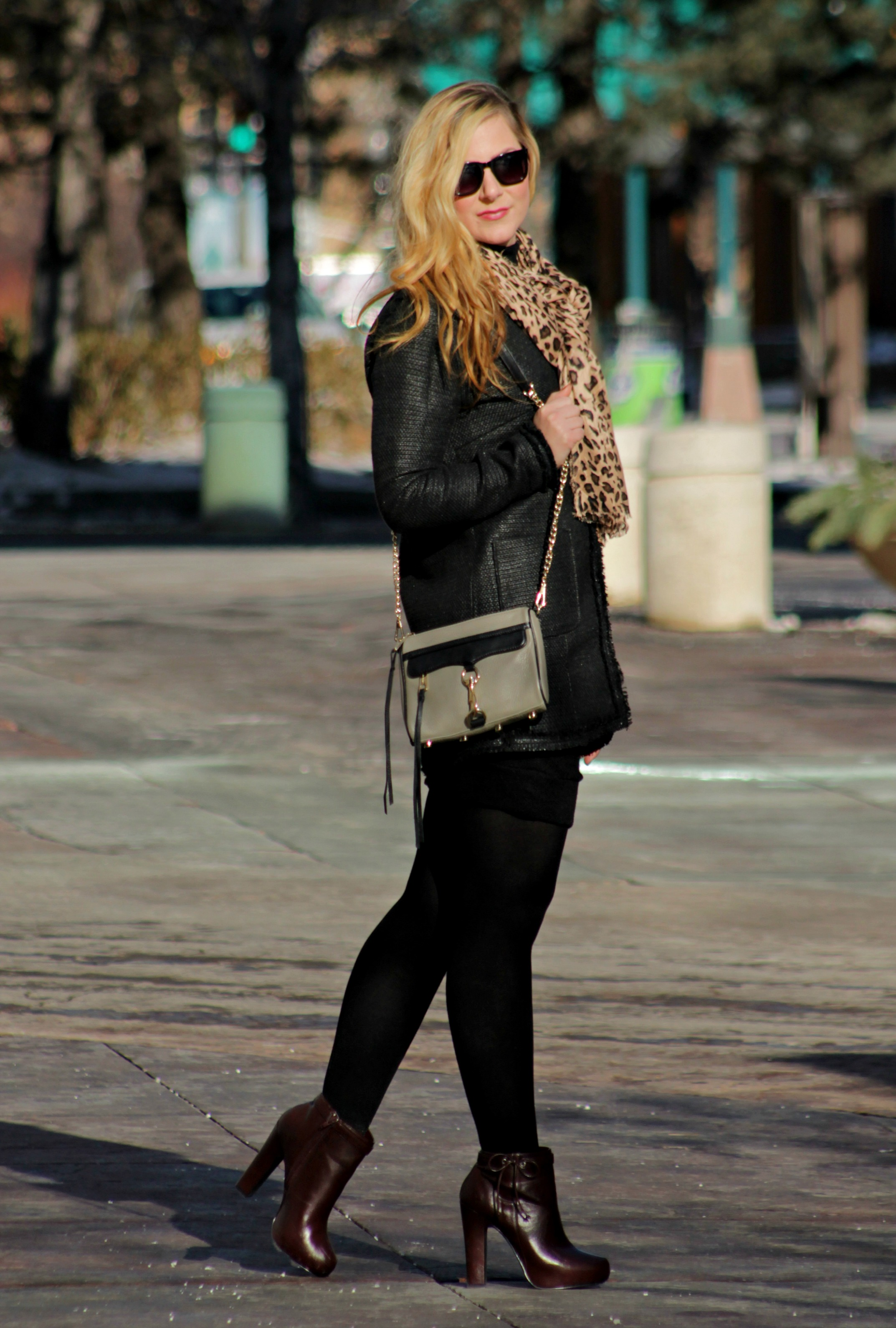 black jacket, leopard scarf, black tights and booties