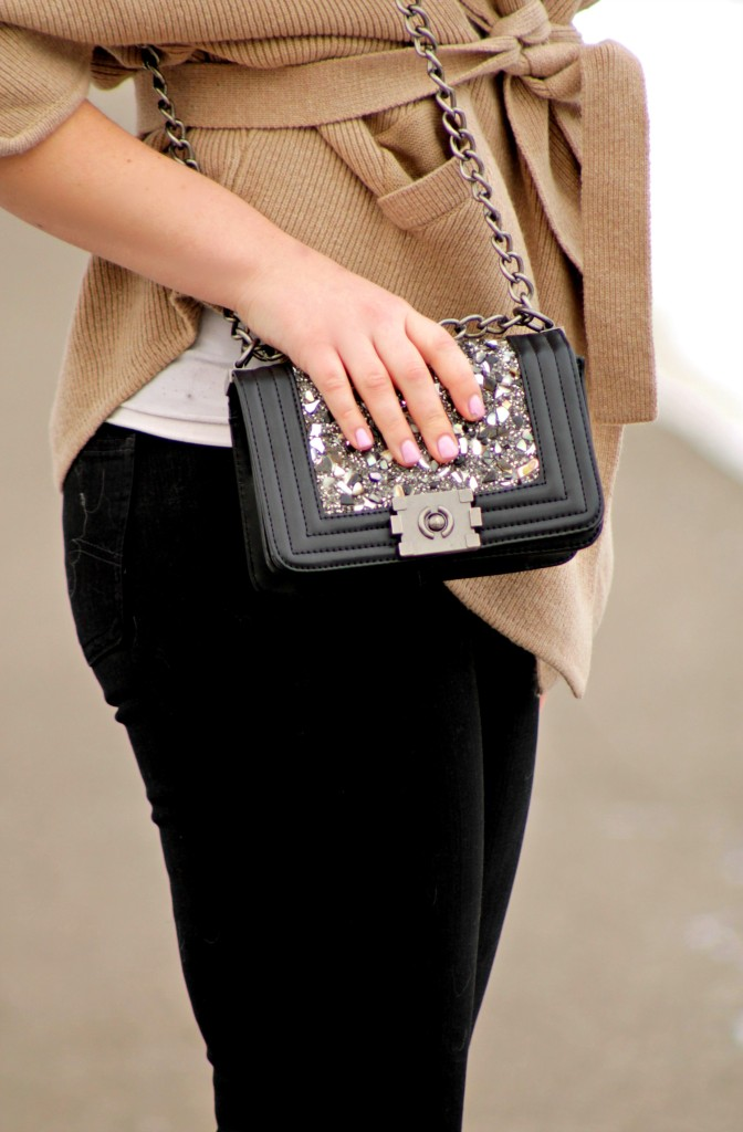 crossbody bag and black jeans