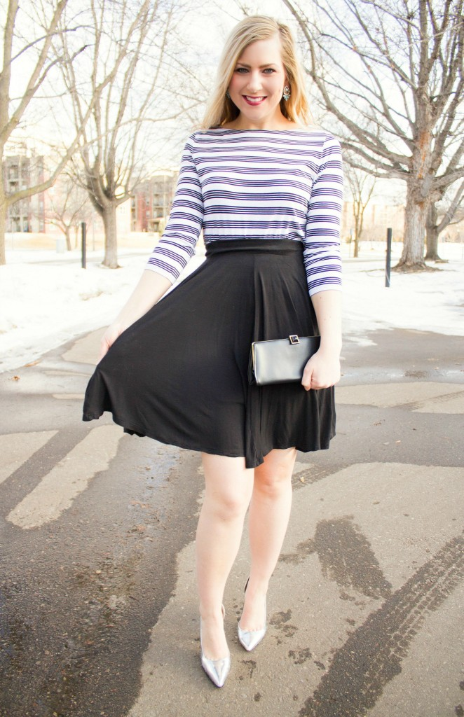 striped top, flowy black skirt, metallic heels