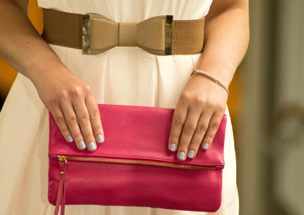 bow belt and pink clutch