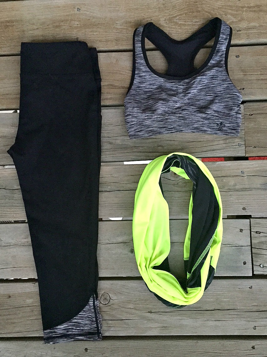 picture of black high-waisted leggings, gray sports bra and neon workout scarf
